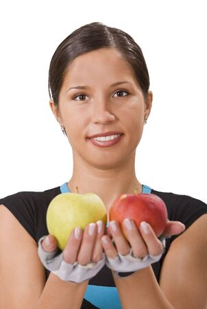 Smilling young sportsgirl offering a red and a green apple and inviting people to a healthy diet. Stock Photo - 3236840