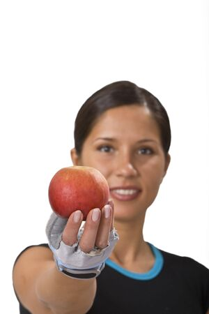 Young sportsgirl offering a red apple-a suggestion for healthy eating. Stock Photo - 3236838