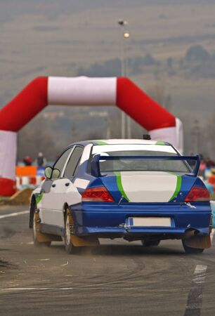 Rally car during the race in a curve. Stock Photo - 3332406
