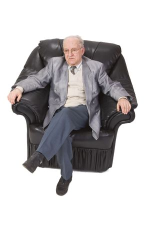 Inage of a senior man sitting in an armchair against a white background. Stock Photo - 3419843