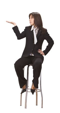 admire: Young businesswoman sitting on a high chair and holding out her hand as if she were displaying something.You can add any text or object on the palm of her hand.