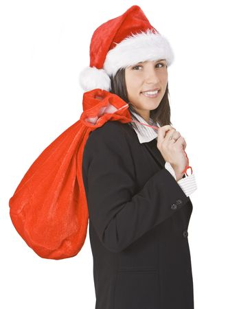 Office girl wearing Santas hat and carrying a red sack. photo