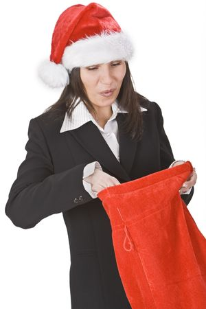 santaclause: Happy young woman in a red hat discovering gifts in Santas sack