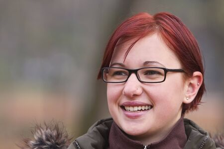 Autumn portrait of a redheaded girl with glasses. Stock Photo - 3625626