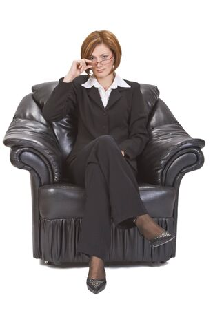 Businesswoman with glasses sitting in an armchair. Stock Photo - 3625625