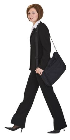 Businesswoman with a shoulder computer bag walking. Stock Photo - 3625619