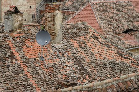 modernity: Amazing contrast generated by a birds eye view of the traditional German medieval roofs from Sibiu- 2007 European Cultural Capital- and a modern antenna.