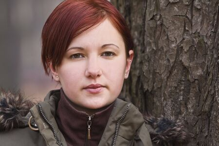 Portrait of a redheaded girl near a tree (autumn colors). Stock Photo - 3674223