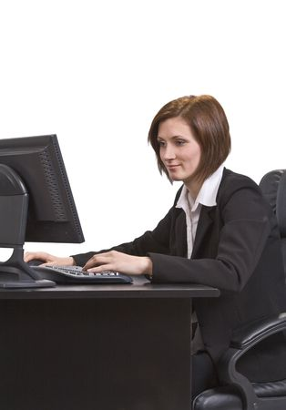 Young businesswoman at her desk browsing the internet. Stock Photo - 3887023