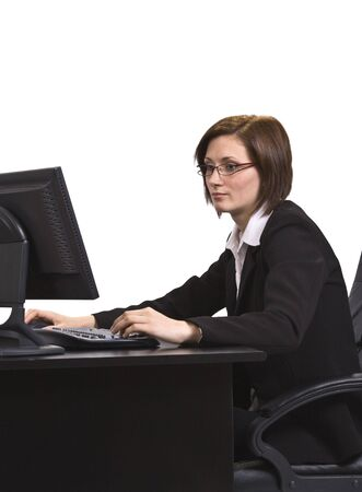 Young businesswoman with glasses at her desk browsing the internet. Stock Photo - 3887028