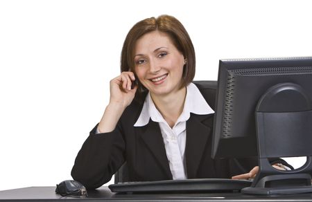 Young smiling businesswoman on the phone at her desk in an office. Stock Photo - 3887026
