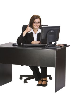 Happy businesswoman with thumb-up sitting on her desk in the office. Stock Photo - 3895825