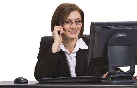 Smiling businesswoman on a mobile phone at his place in the office. Stock Photo - 3895848
