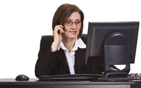 Businesswoman at her office desk using a mobile phone and bitting her lower lip. Stock Photo - 3904737