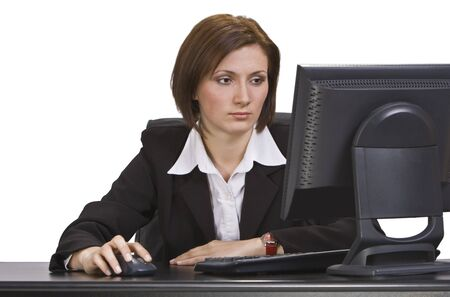 webdesigner: Businesswoman working on the computer at her workplace.