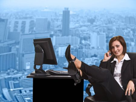 concave: Businesswoman relaxing on the mobile phone in front of the concave glass wall of the office in a big city. Stock Photo