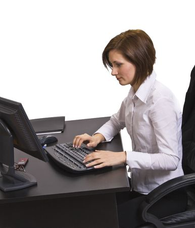 Young businesswoman at her desk browsing the internet. Stock Photo - 3913305