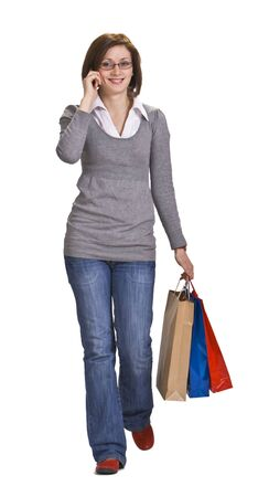 Young woman with shopping bags using a mobile phone. photo