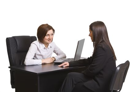 clarification: Two businesswomen at an interview in an office. Stock Photo