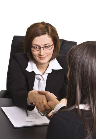 Businesswomen shaking hands in the office. Stock Photo - 4029410