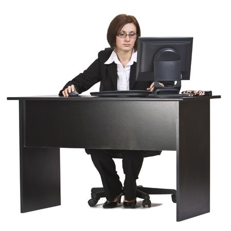 Businesswoman working on a computer at her office desk isolated against a white background. Stock Photo - 4047277