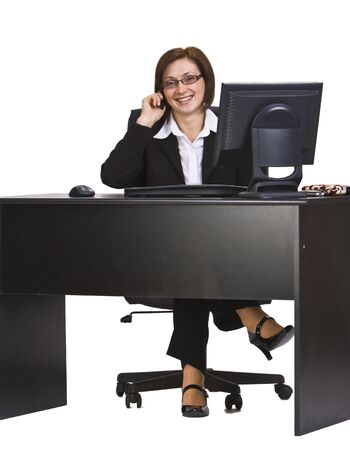 Happy businesswoman ather office desk on the mobile phone. Stock Photo - 4054797
