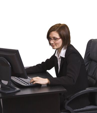 Young businesswoman with glasses at her desk browsing the internet. Stock Photo - 4054799