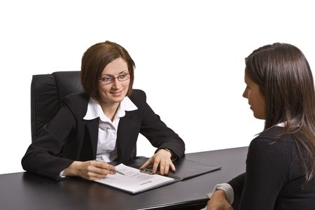 Two businesswomen at an interview in an office.The documents on the desk are mine. Stock Photo