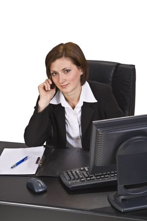proffessional: Businesswoman on a mobile phone at his place in the office. Stock Photo