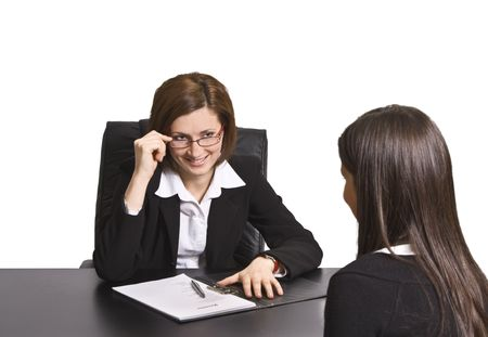Two businesswomen having fun at an interview in the office.The documents on the desk are mine. photo