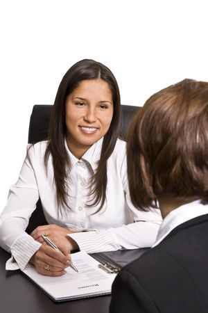 meet: Two businesswomen at an interview in an office.The documents on the desk are mine. Stock Photo