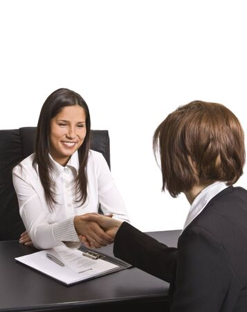 Businesswomen shaking hands in the office.The documents are mine. photo