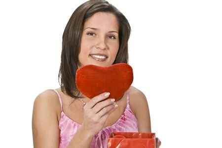 Happy young woman taking a plush heart out of a red gift box. Stock Photo - 4100022