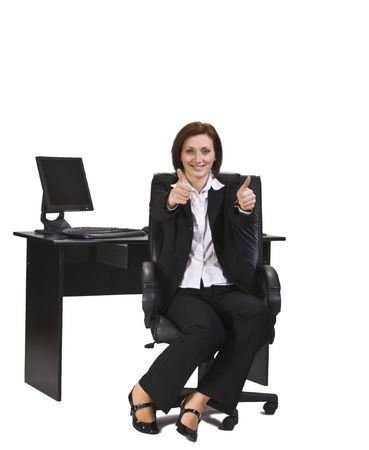thumbup: Successful businesswoman on her desk isolated against a white background.