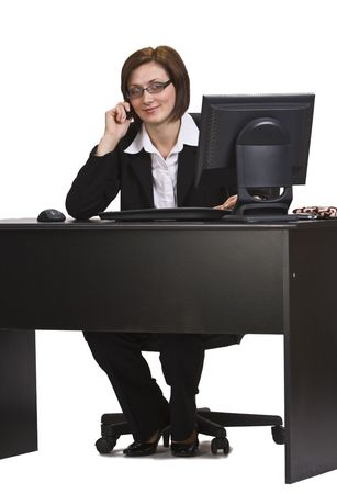 Businesswoman at her office desk on the mobile phone. Stock Photo - 4164489