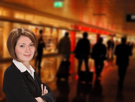 Portrait of a young businesswoman in a commercial area of an airport. Stock Photo - 4164493