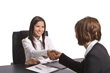Businesswomen shaking hands in the office.The documents are mine. Stock Photo - 4184155