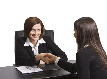 Businesswomen shaking hands in the office.The documents are mine. Stock Photo - 4247190