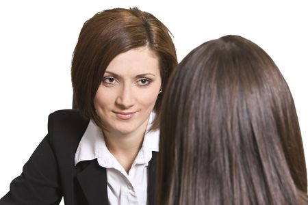 Two businesswomen discussing during a job interview. photo