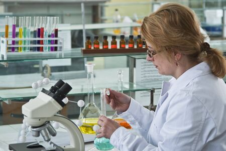 Female researcher opening a glass recipient in the chemistry laboratory. Stock Photo - 4520368