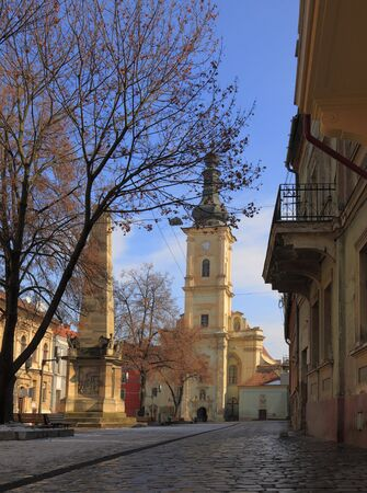 franciscan: Old town square (Museums square) in front of the Franciscan Church,Cluj Napoca Romania. On the left you can see Carolinas column.