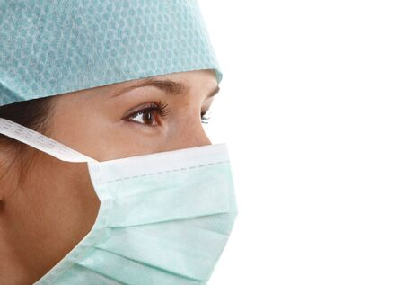 Portrait of a young woman surgeon wearing a mask. Stock Photo - 4728199