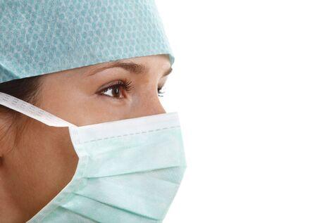 perfil de mujer rostro: Retrato de una joven mujer llevando una m�scara de cirujano.