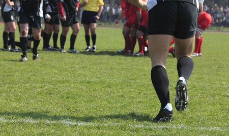 substitution: Abstract image of a team game (rugby) moment- substitution.