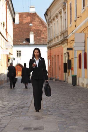 Businesswoman checking her mobile while walking. Stock Photo - 4871144