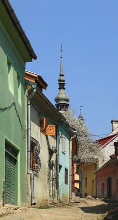 backstreet: Old backstreet between houses in Sighisoara,Romania. Stock Photo