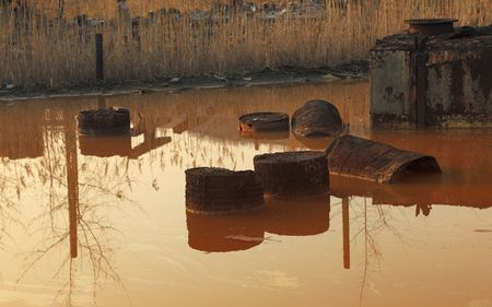 dross: Image of a pond with very toxic industrial drosses. Location: Copsa Mica,Romania, a town which in 1990 was known as one of the most poluted places in Europe. Stock Photo