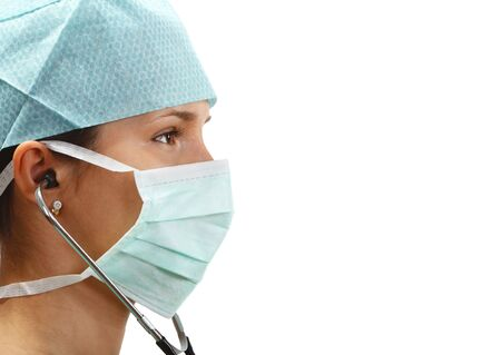 in readiness: Profile of a female doctor with mask and stethoscope isolated against a white background.