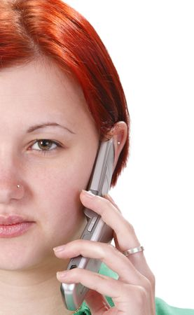 Half of the face of a young girl who is using a mobile phone. Stock Photo - 5308790