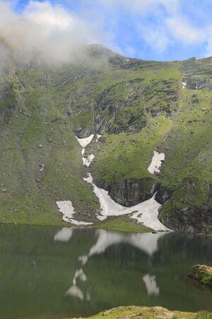 Mountainous landscape with a lake.Location:Balea Lake from Fagaras Mountains,Romania. photo